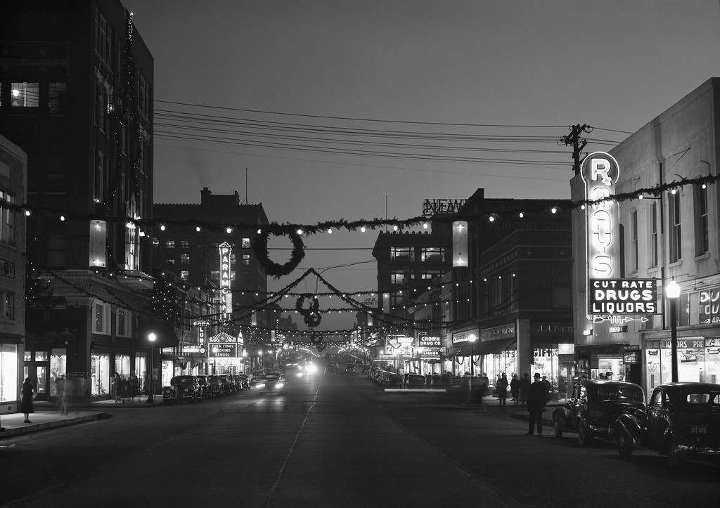 Joplin's downtown commercial district was aglow with Christmas spirit in 1941. An assortment of colored lights and traditional evergreens were strung across Main Street, inviting visitors and Joplin citizens to begin their Christmas shopping. The photo was taken at 5th and Main looking south. Joplin residents were also encouraged to participate in the decorating festivities. Members of the Joplin Junior Chamber of Commerce held a best decorated home contest. Sixty dollars in cash prizes were set aside for the winning entries.